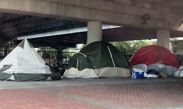Tents along St. Charles Avenue under the overpass of U.S. 90. (Credit: Caleb Bloomfield)