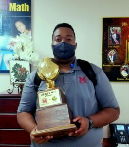 Student proudly shows off the game trophy