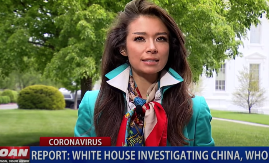 Chanel Rion reporting in front of the White House.
