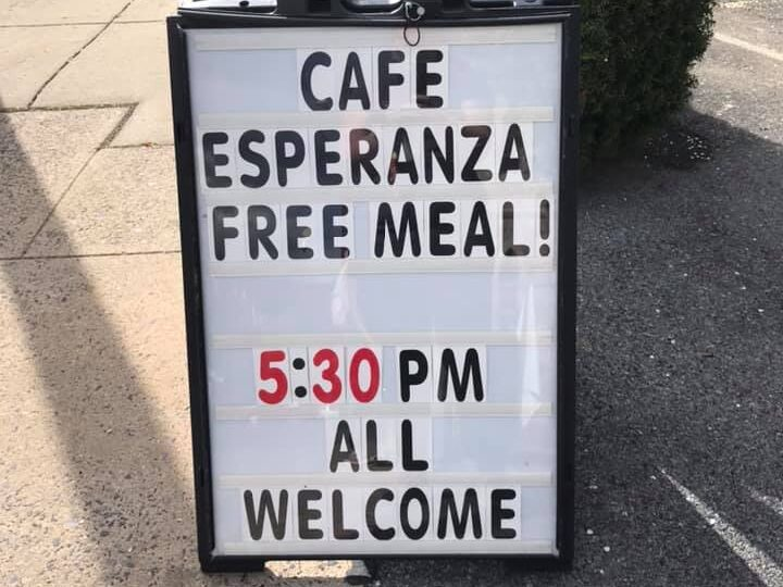 "Sign outside of Cafe Esperanza says, ""All are Welcome."""