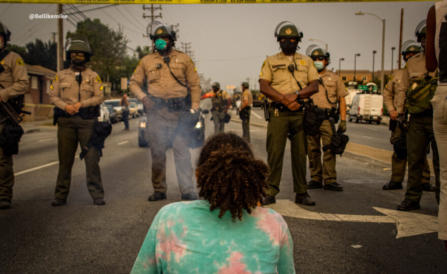 Dijon Kizzee protester in front of a line of LA Sheriff Deputies [Photo credit: Michael Ade]