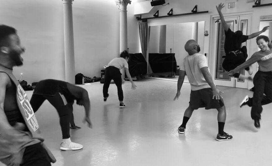 Dancers dancing inside a dance studio