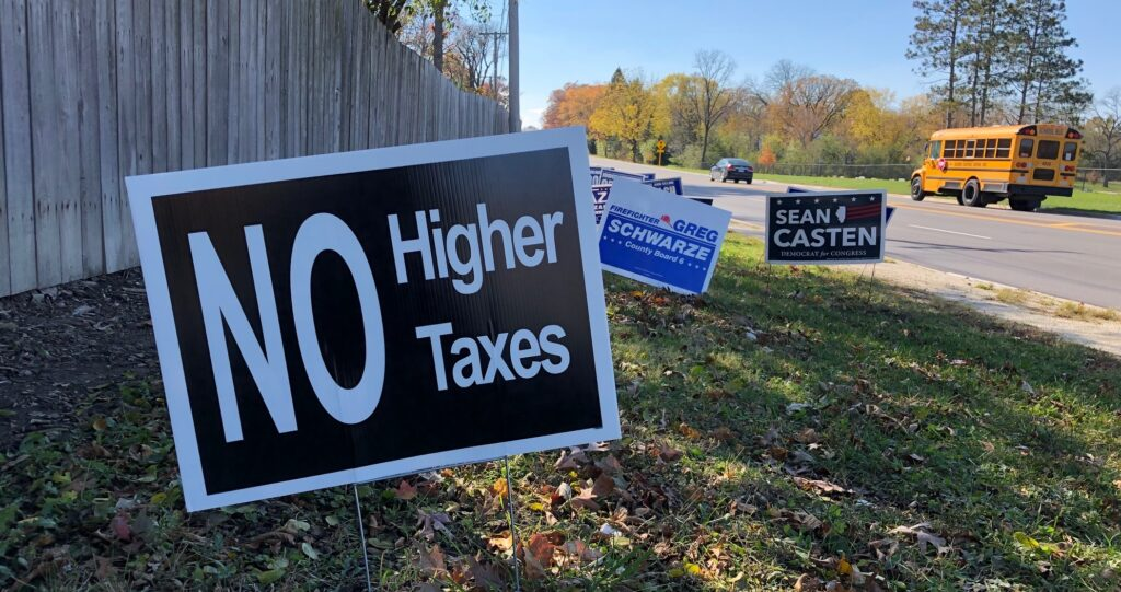 Political signs promoting no higher taxes