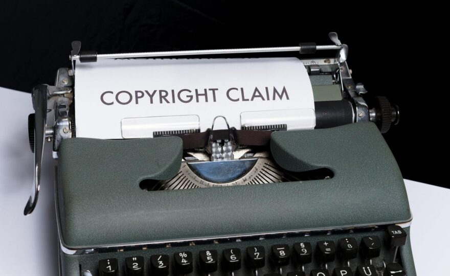 """Typwriter with paper that says """"copyright claim"""""""