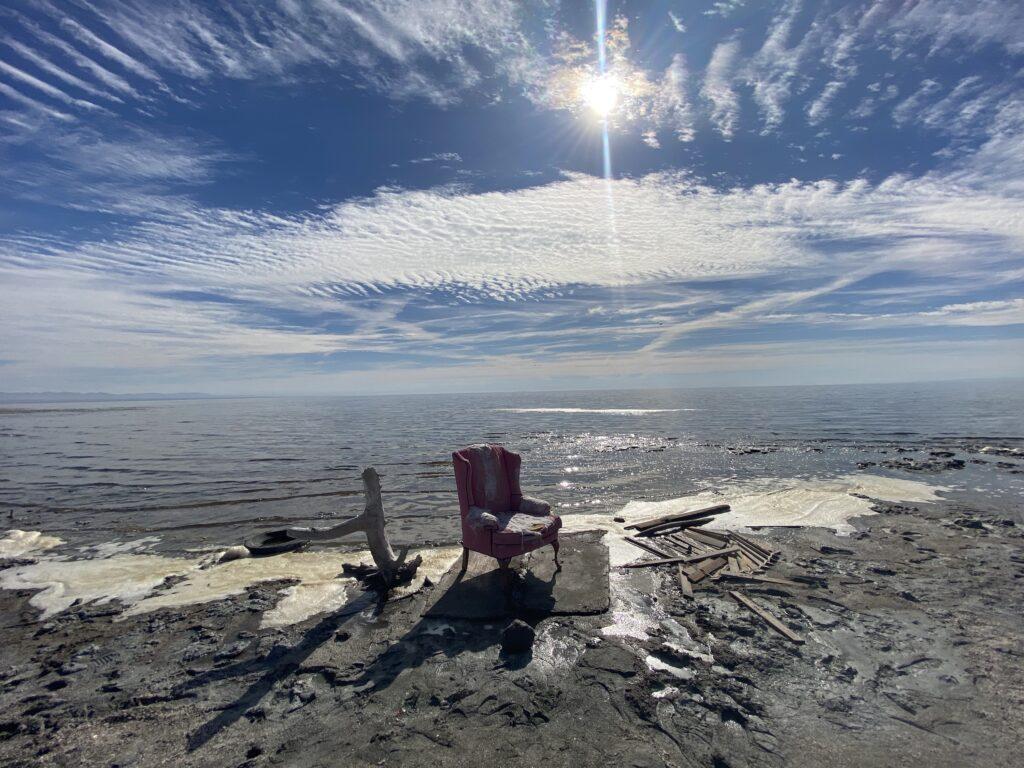 Pink chair at edge of Salton Sea, Bombay Beach Ruins