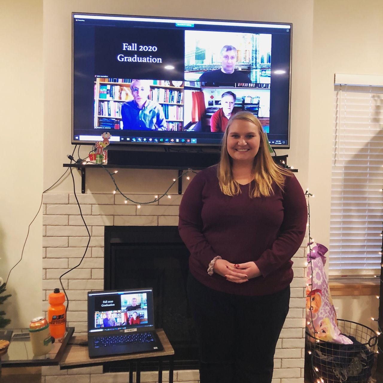 Megan Jarrett in front of the Zoom virtual graduation ceremony.