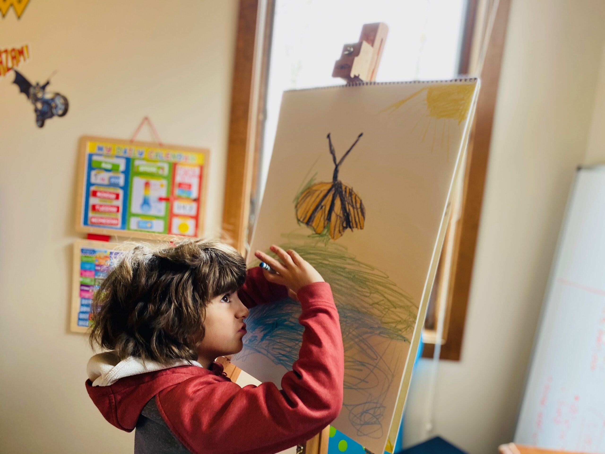 Adriana Letorney's son and his drawing of a butterfly during lockdown; she caught him imagining the butterfly flying free. [Photo courtesy of Adriana Letorney]