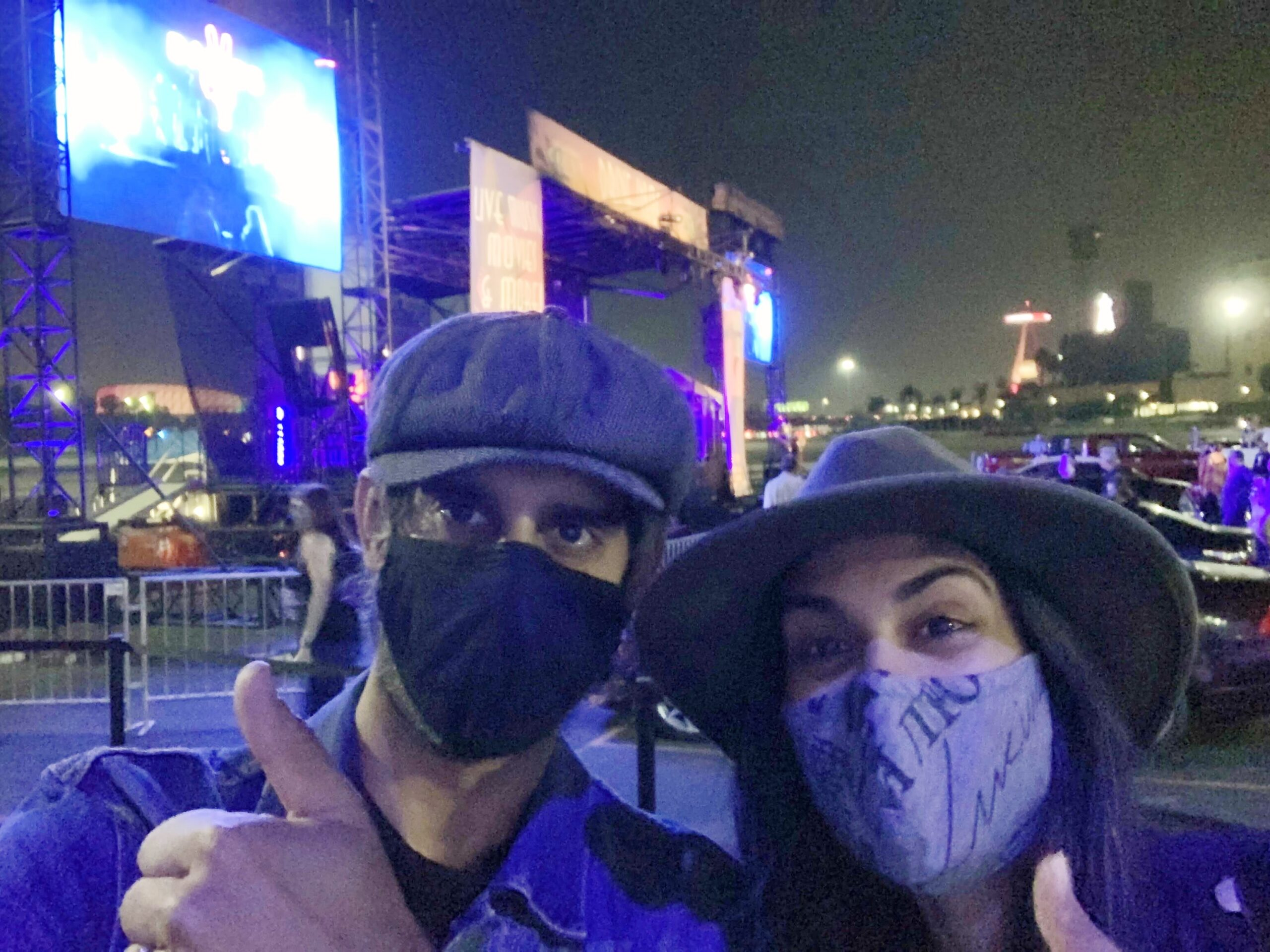 Sonya Singh and her brother attend a drive-in concert last fall. It was their one live-music experience during the pandemic, and they've never been happier to hang out in a parking lot. [Photo courtesy of Sonya Singh]