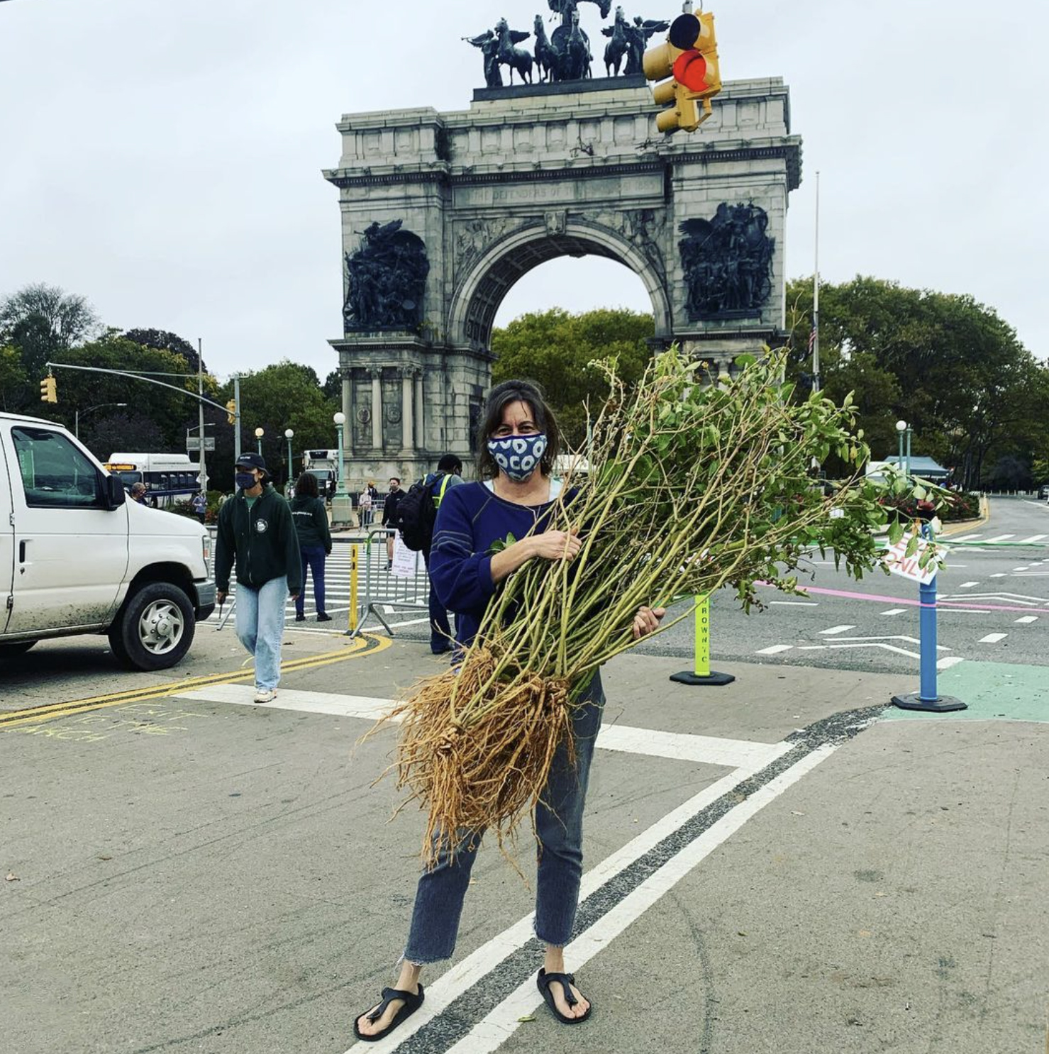 Grace Galanti at the Prospect Park Farmers Market with Ashwagandha plants, Oct. 24, 2020.