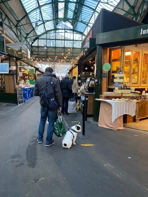 Customers in a social distanced que at Borough Market