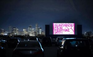 Sundance Film Festival projected onto the screen at Moonstruck Drive-In [Credit: Instagram @moonstruckdrivein]