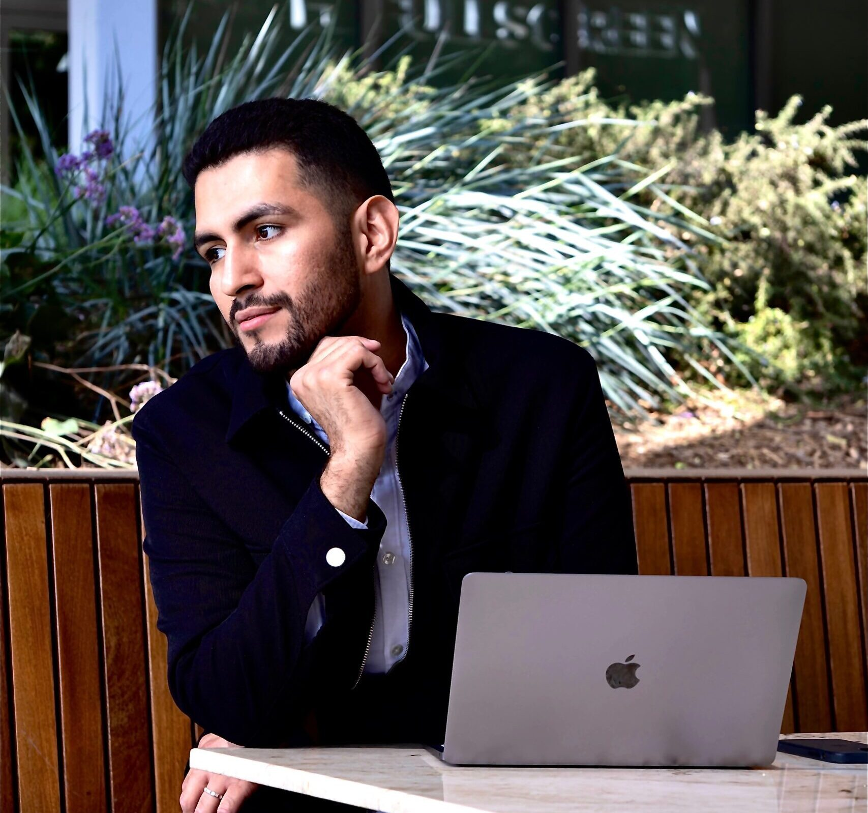 Los Angeles stylist Alec Lopez pictured sitting in from of his laptop working