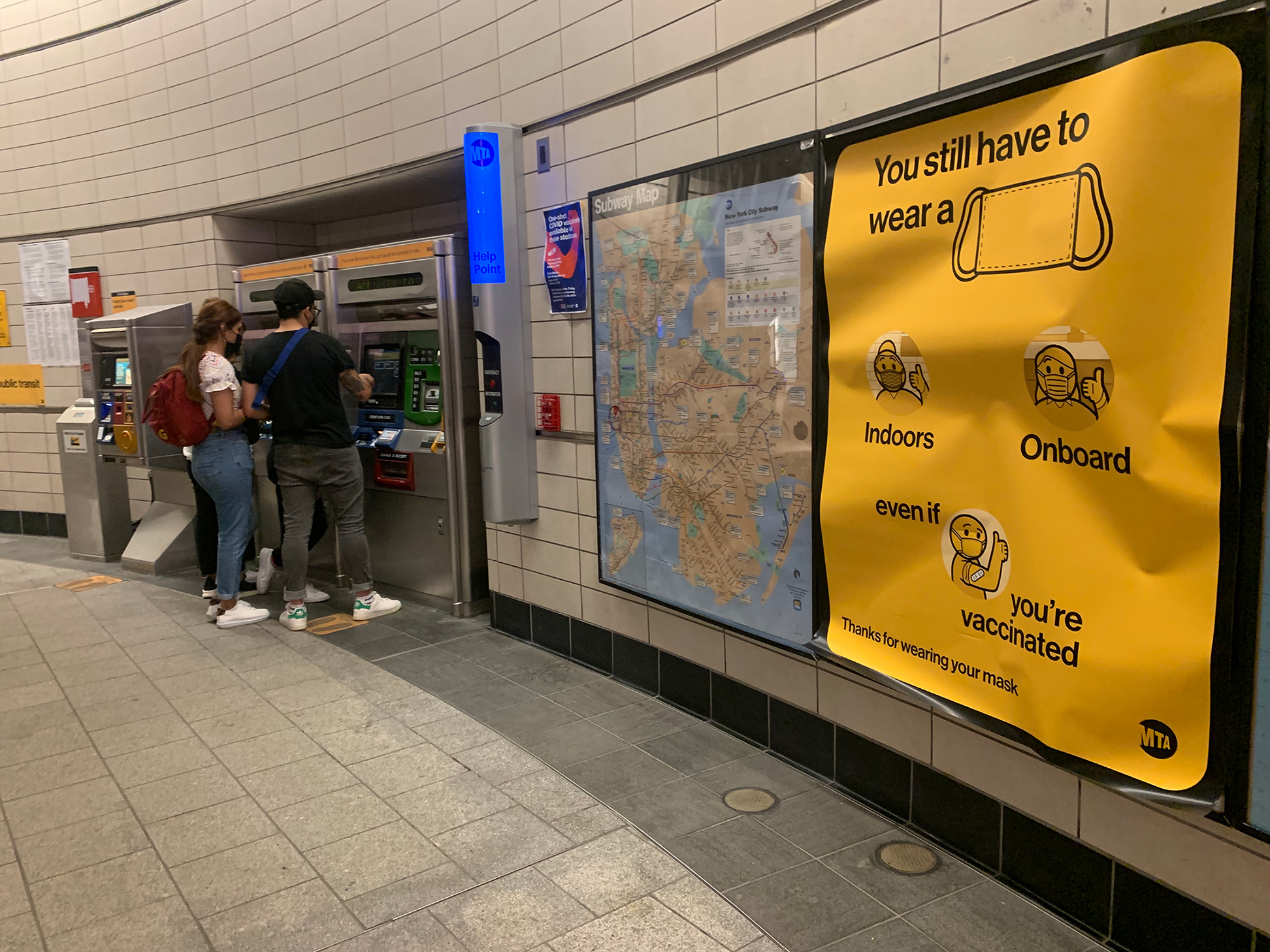 A sign in the 34th Street-Hudson Yards MTA station reminds riders of the rules regarding masks on New York City's public transit system.