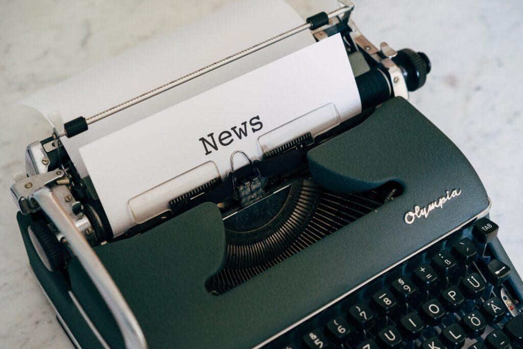 Typewriter with news on it
