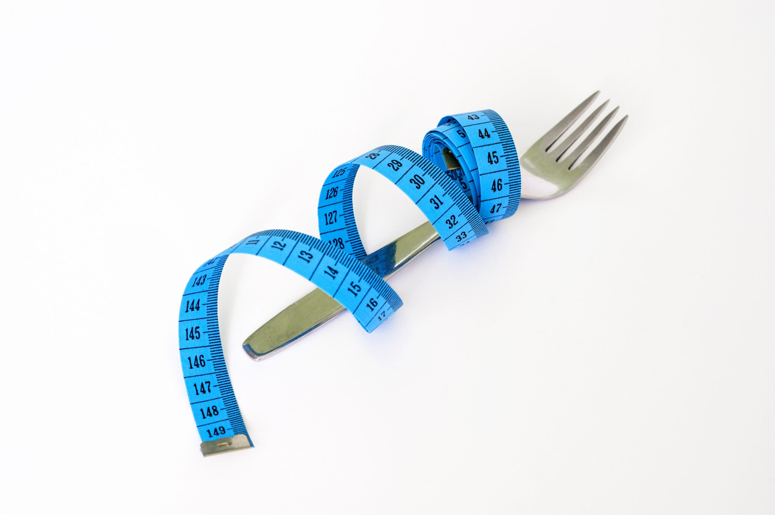 Measuring tape and fork stock photo
